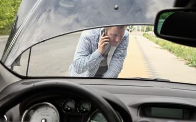 Broken car - a man calling for help