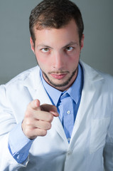 Closeup portrait of handsome young doctor giving a warning