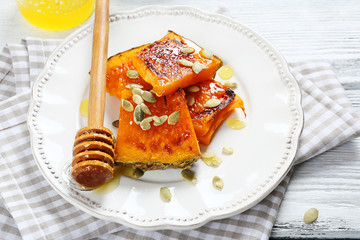 Pumpkin with honey on a plate