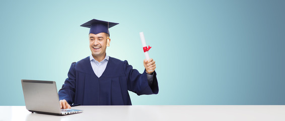 smiling adult student in mortarboard with diploma