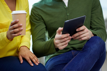 close up of students with tablet pc and coffee