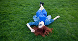 women lying down on green grass
