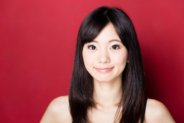 attractive asian woman beauty image on red background