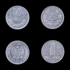 Two Collectible coins on a Black Background.