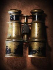Vintage binoculars on old paper