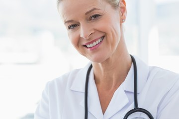 Close-up view of happy doctor looking at camera