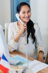 Pretty businesswoman having phone call