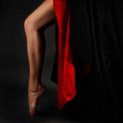 Beautiful leg with red and black skirt