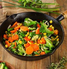 Stir fried vegetables in   skillet .
