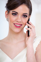 beautiful bride and mobile phone
