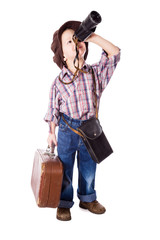 Boy with suitcase looking to spyglass