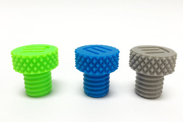 Three Plastic Screw Bolts printed by 3D Printer on White