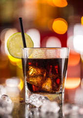 Glass of cola drink on bar counter