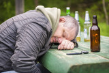 Drunk men sleeping on table