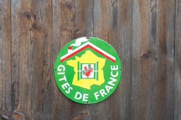 """A sign """"Gite de France """" B&B in french on wooden background"""