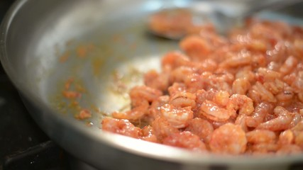 cooking king shrimp in pan