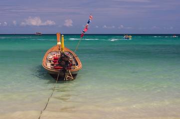 Longboat floating on the beautiful blue Andaman Sea