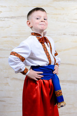 Proud young boy in a colorful costume