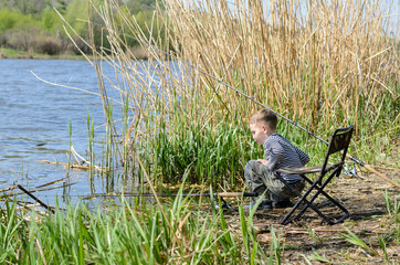 Young boy fishing with a rod and reel