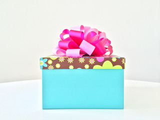 Blue gift box with pink ribbon