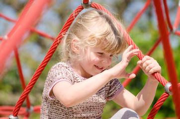 blond girl in playground