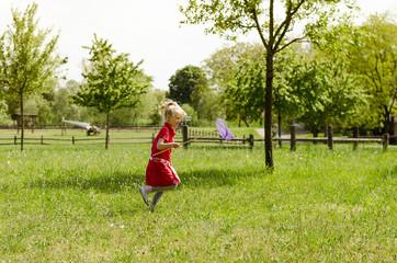 girl catchind butterflies