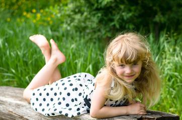 beautiful blond girl on bench