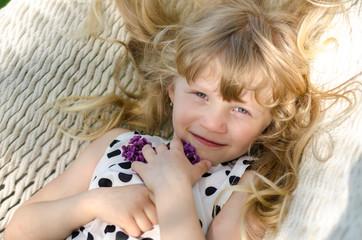 portrait of child lying in hammock