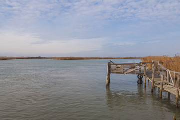 Wooden pier at Po' river estuary, Italy