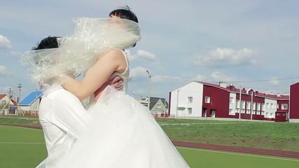 Bride and groom on the football field, loving feelings, HD video