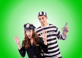 Police and prison inmate on white