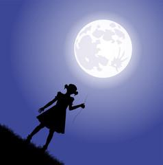 silhouette di bambina che tiene al laccio la luna
