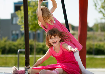 Two young girls having fun on a playground