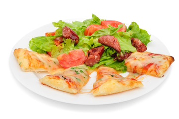 Pizza slices and salad