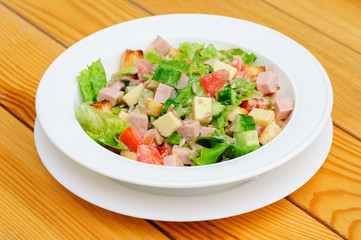 salad with cheese, ham and fresh vegetables
