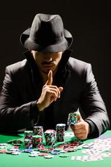 Man playing in dark casino