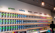 Store interior with bright tea containers on shelves