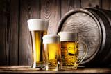 Two glasses and mug of light beer