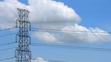high voltage electricity pylon with moving cloud, time lapse