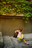 The little girl and a cat
