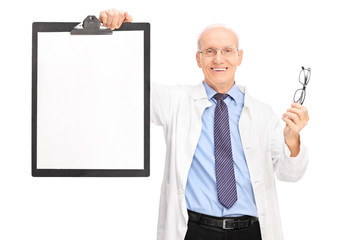 Optometrist holding glasses and a clipboard