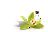 Fototapety Spa concept. Green orchid and spa oil, isolated on white.