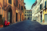 Street of a typical Italian town with bike and bicycle - 83709643