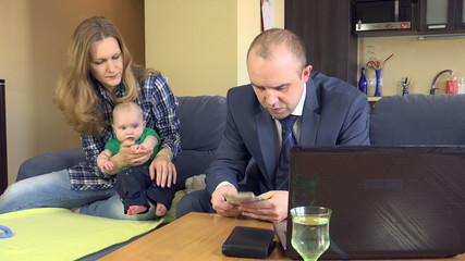 father count family budget. Mother with baby play on sofa. 4K