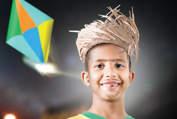 Boy wearing caipira clothes for the Brazilian Junina Party