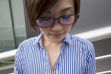 Women wearing glasses is facing downward