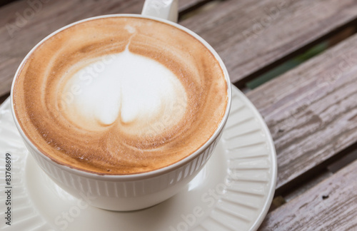 Foto op Canvas Chocolade Heart shaped latte on a wooden floor.