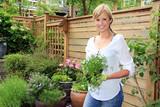 Fototapety Lady gardener in the garden..