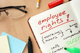 Notepad with words employee rights  concept and glasses