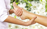 Foot massage in the spa salon in the garden. - 83825064